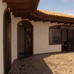 An exterior view of the deck & house at Casa Blanca