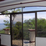 Casa Blanca's master bedroom has deck access and a maginficent view