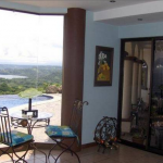 The breakfast nook looks out over the pool and bay here at Casa Blanca